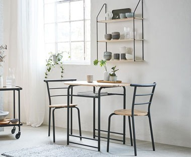 Dining table and dining chairs in black and oak