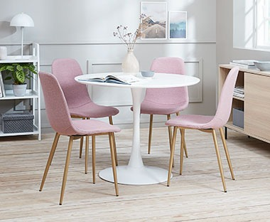 Round dining table and dining chairs in rose
