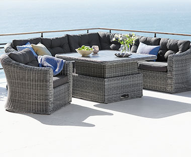 Grey lounge set including table for 5 people