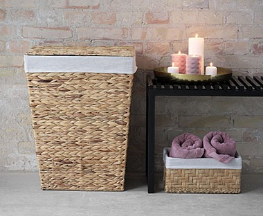 Natural straw laundry basket in bathroom