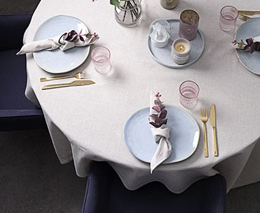 Table linen in natural colour with table setting