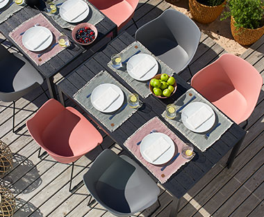 Outdoor plastic chairs in pink or grey with black metal legs