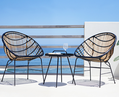 Steel and polyrattan outdoor lounge chair