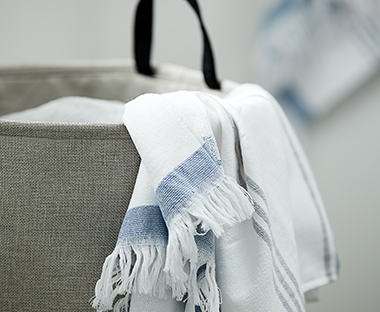 Grey laundry basket with handles