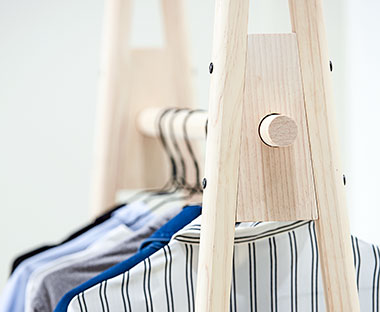 Black wire hangers on clothes hanging rail