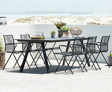 Artwood and metal table with stackable garden chairs