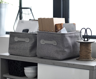 Grey storage baskets and boxes