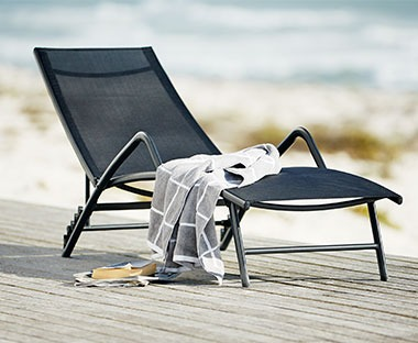 Black sunlounger with recliner back
