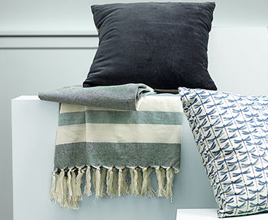 Soft blanket throw, grey striped pattern and tassel ends