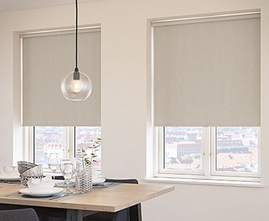 Trimmable spring loaded roller blind in beige colour
