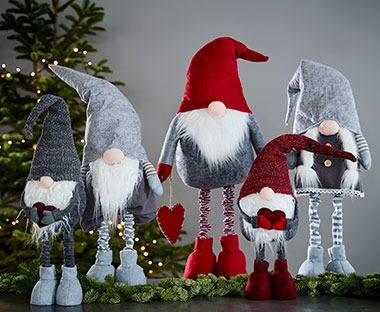 Decorative father christmas characters with hats and beards