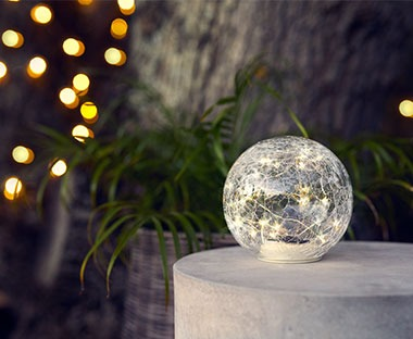 Clear round solar lamp filled with small fairy lights