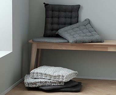 Several soft cushions available in wintery colours