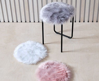 Fluffy fake fur chair cushions available in rose, off-white and grey
