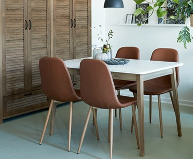Rectangular white dining table with solid oak legs