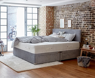 Light grey fabric divan base with four drawers with matching headboard