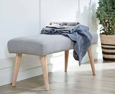 Grey fabric bench with wooden legs