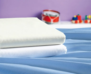 Folded white high quality bed sheets