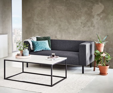 2.5 seater sofa paired with concrete coffee table