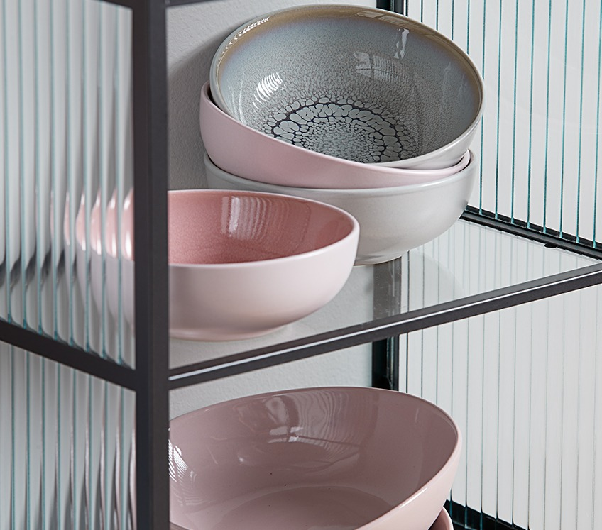 Bright coloured bowls on glass shelf