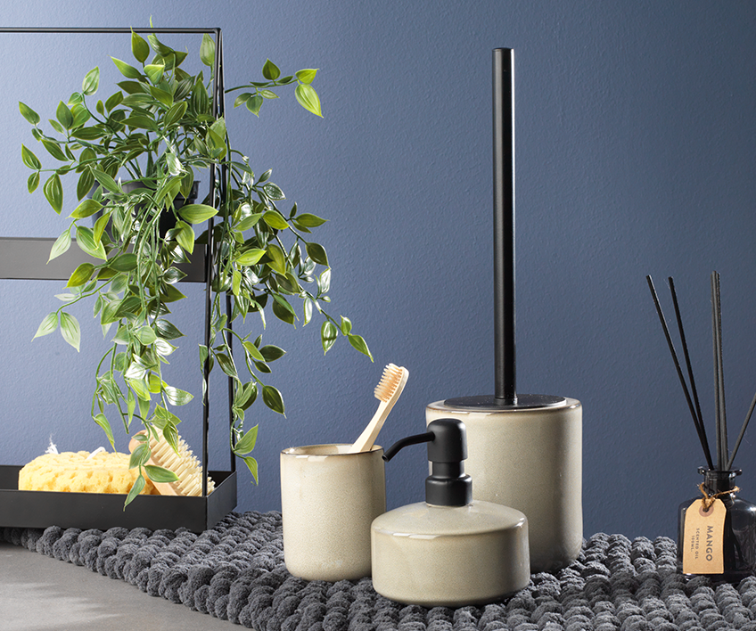 Faux plant shown as a part of bathroom décor ideas