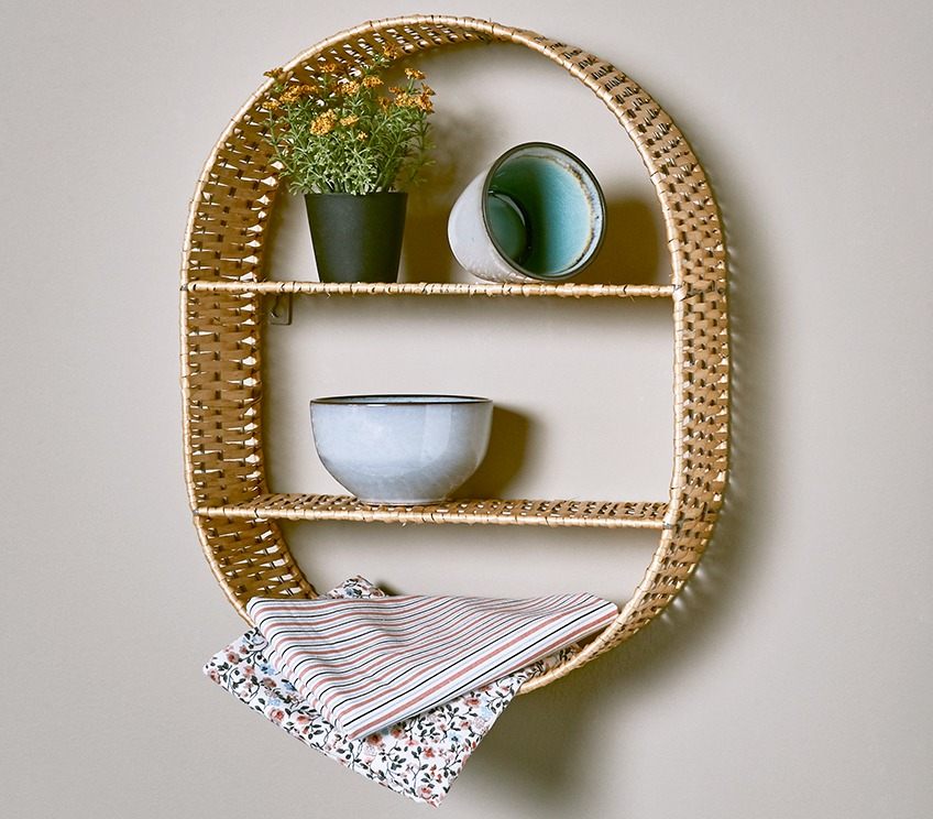 Small wall shelf with mug, bowl and faux flower