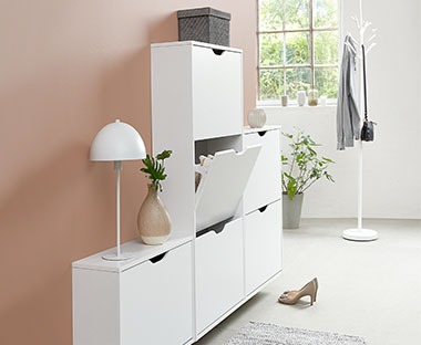 White shoe cabinet with various compartments